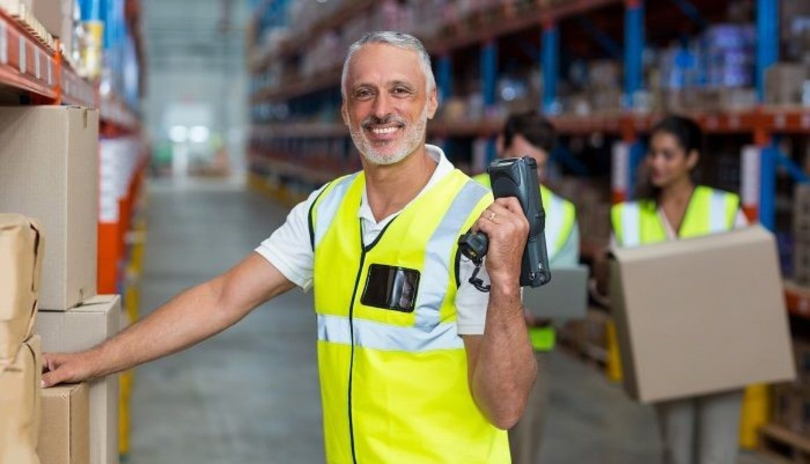 factory working posing for a picture | Consolidated Strategy Group