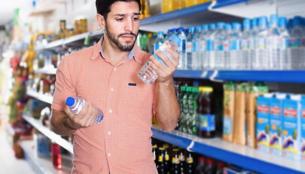 man choosing water bottle